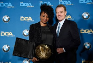 "Director Dee Rees, left, poses with presenter Bryan Cranston backstage after winning the Movies for Television and Mini-Series Award for ""Bessie"" at the 68th Directors Guild of America Awards at the Hyatt Regency Century Plaza on Saturday, Feb. 6, 2016 in Los Angeles. (Photo by Chris Pizzello/Invision/AP)"